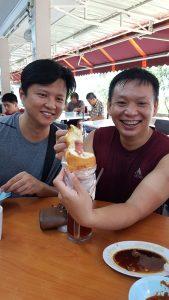 friends enjoying the hotdog bun by sin chew confectinery